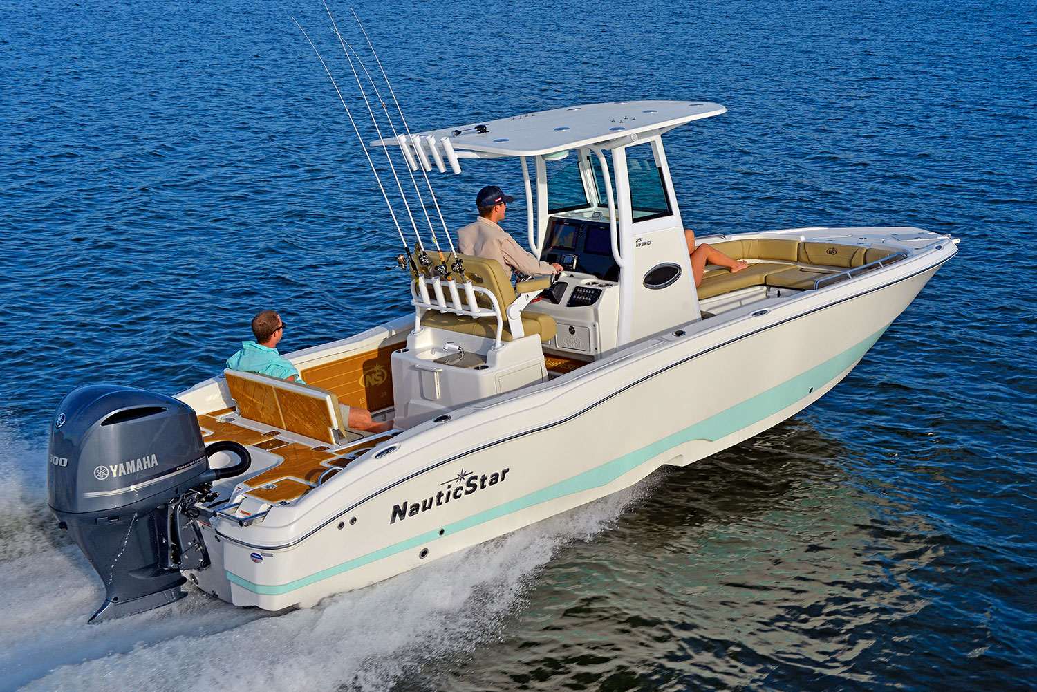 A man captaining the NauticStar 251 Hybrid with one man looking on the water